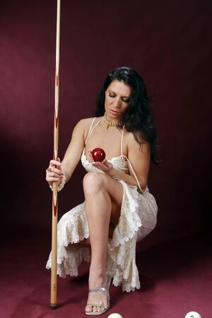 beautiful young women with accessories for billiards photo