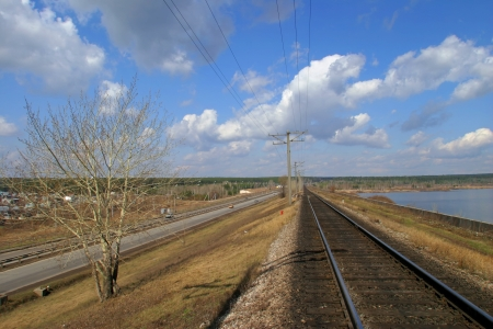 railroad and highway are close to each other photo