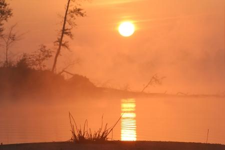 sunrise on the Kama River in the fog Stock Photo - 18436417