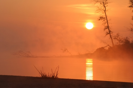 sunrise on the Kama River in the fog photo