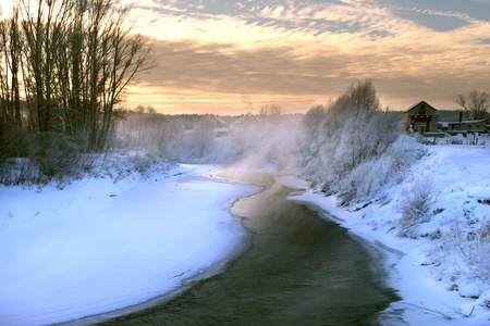 consecrated: scenic winter landscape river and trees consecrated rising sun