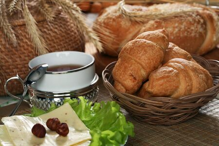 pastries, fruits, cheeses, nuts, wheat and lettuce on the table photo