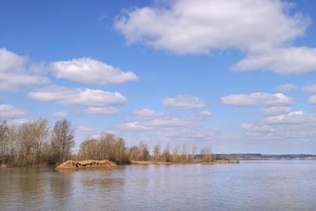 spring flooding river on a sunny day photo