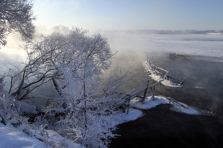 landscape winter morning on the river Zai photo