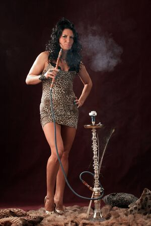 Glamor portrait with a hookah pipe and smoke Stock Photo