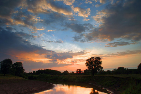 sunset on the river in the middle of summer Stock Photo