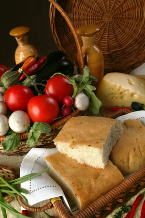 bakery products: macro bread and vegetables in wicker baskets