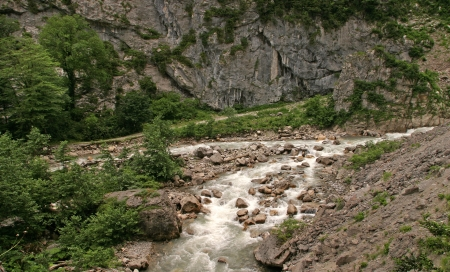 Summer landscape mountain river Gagra ridge Gega  in Abkhazia photo