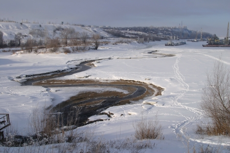 Winter landscape river and power lines on the coldest winter day photo