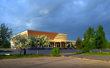strategical: the building of the Organ Hall of Naberezhnye Chelny in the spring at sunset on the background of the cloudy sky