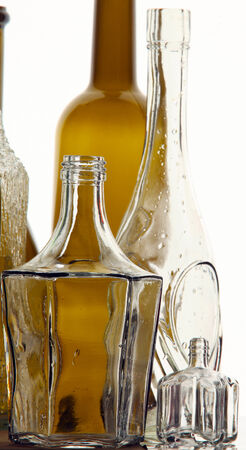 close-up beautiful bottles of white and brown glass on white background studio light photo
