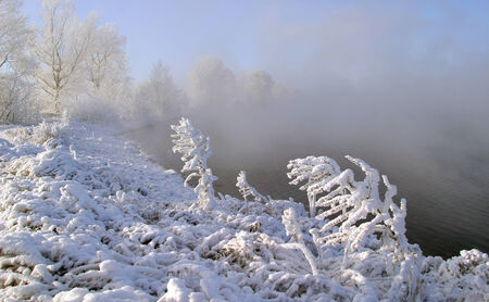 tatarstan: Winter landscape frosty misty morning on the river and trees in hoarfrost Stock Photo