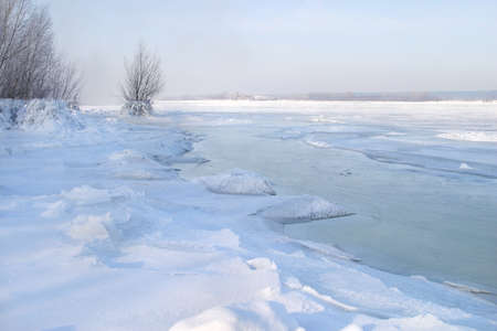 tatarstan: Scenic winter landscape beneath the ice reservoir wonderful blue sky fog and frost on the trees on the shore