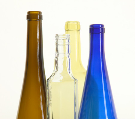 close-up of colored glass bottle necks isolated on white background studio photo
