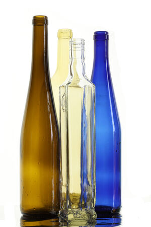 close-up of beautiful colorful empty bottles without caps isolated on white background studio photo