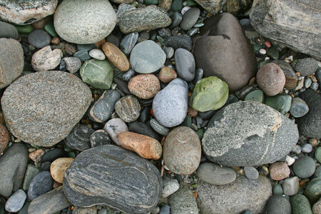 isolated close-up of beautiful rocks on the shore of a mountain river in summer photo