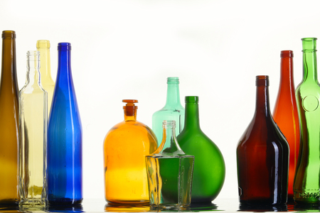 close-up of beautiful colorful empty bottles without caps isolated on white studio photo