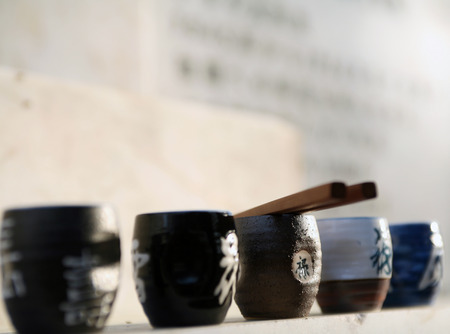 close-up Japanese cups on the monument cemetery Japanese POWs in Elabuga