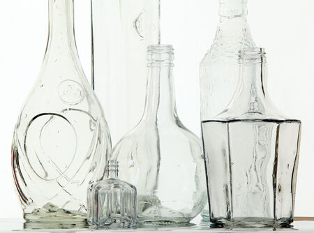 close-up empty white transparent bottle bizarre shapes on white background studio light photo