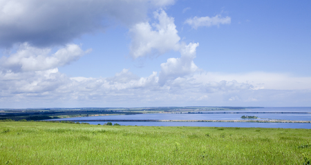 boundless: summer landscape beautiful clouds in the blue sky over a broad river on a sunny day