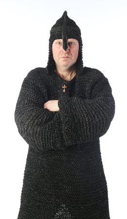 portrait of adult bald white man in chain mail and a helmet on a light background studio Imagens