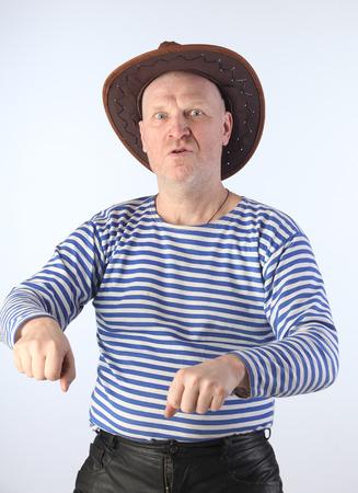 striped vest: portrait of adult white men in striped vest and cowboy hat studio