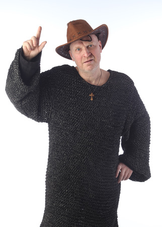portrait of adult bald white man in chain mail and cowboy hat on a light background studio photo