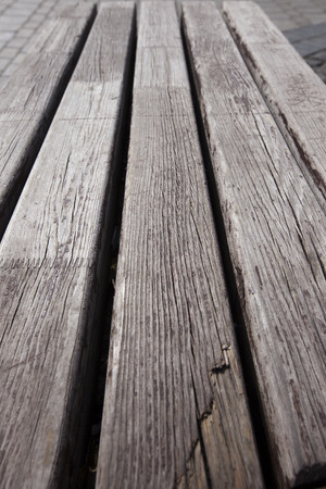 close-up texture fragment of the wooden bench in the park in spring photo