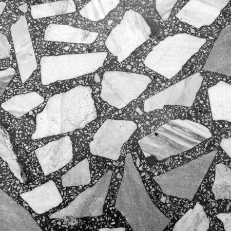 marble flooring: close-up frammento di pavimento in marmo grigio e bianco
