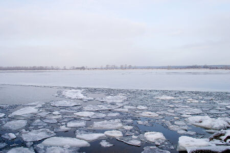 partially: winter landscape wide navigable river is partially covered with ice in early winter cloudy day Stock Photo