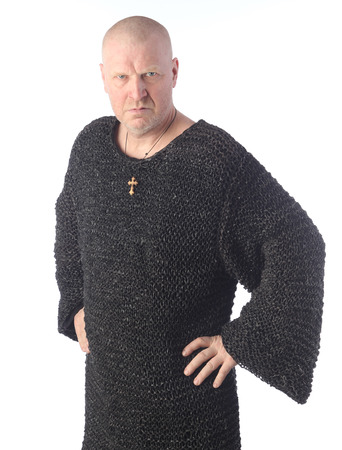 portrait of adult bald white man in chain mail on a light background studio Imagens