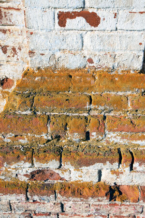 crumbling: close-up texture fragment of the old crumbling temple walls of red brick