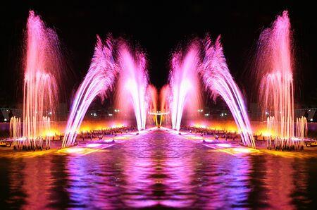 beautiful fountains illuminated at night in the resort area of Egypt Stock Photo
