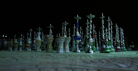 close-up on the pavement a few hookahs Egypt in the night sky