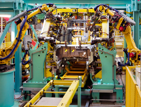 domestic production: interior of modern automated assembly line for cars in during operation Stock Photo
