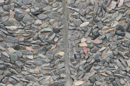 attribute: macro texture of gray wall with small stones