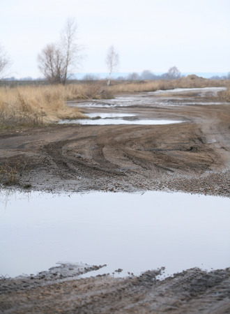 landscape season of bad roads, slush and snow melt in early\ spring