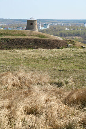 kama: Tower of ancient Bulgar fortress on a high cliff on the banks of the Kama River sunny spring day