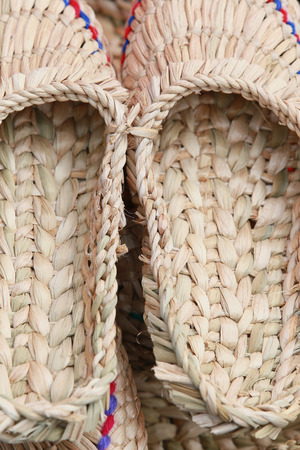 pauper: close-up texture of natural material handmade pair of bast shoe Stock Photo
