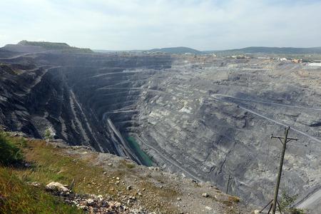 dragline: Pit mining in summer, Karagaysky careers mining magnesite Stock Photo