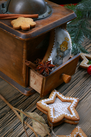 close-up of beautiful festive Christmas still life of the branches of spruce, cookies and spice on wood background with cracks studio photo