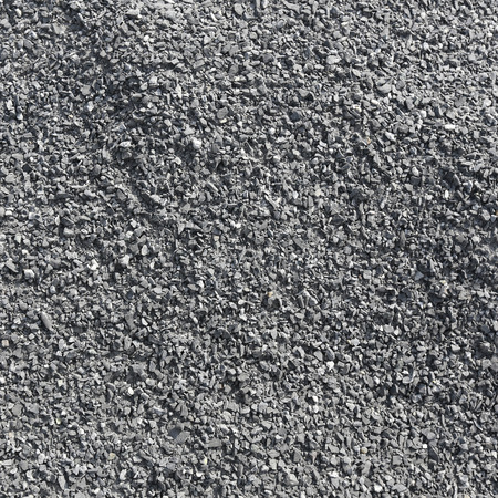 isolated on gray: close-up texture isolated gray stone in natural lighting