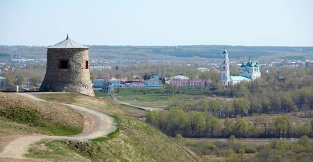 elabuga: Tower of ancient Bulgar fortress on a high cliff on the banks of the Kama River sunny spring day