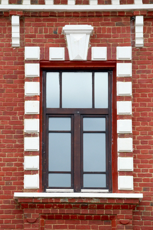redbrick: close-up of a large window on an old red-brick building