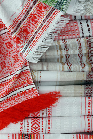 Macro texture of towels embroidered with the national red-white at the fair of folk crafts Stock Photo