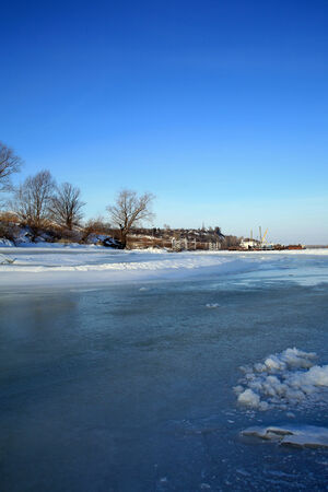 backwater: winter landscape backwater in the ice against the blue sky on a clear sunny day Stock Photo