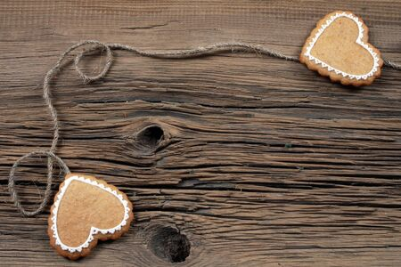 coupled: close-up of cookies in the shape of heart coupled with string on the old boards studio