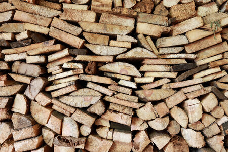 treated board: Close-up texture of a pile of wood logs and board