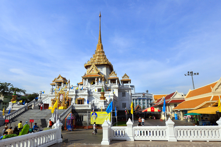 tons: BANGKOK, THAILAND - December 15, 2014: Wat Traimit, Famous for its gigantic, three-meters tall and 5.5 tons Buddha Image, made of solid gold during the Ayutthaya period in BANGKOK, THAILAND