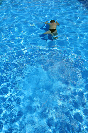 azure: isolated azure water pool and swimmer in the water Stock Photo
